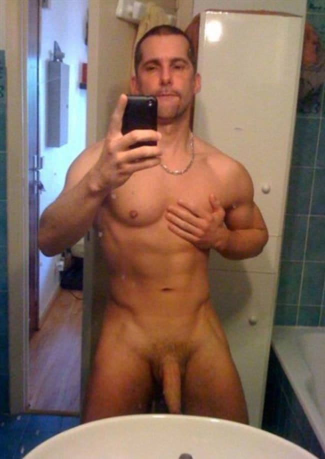 Muscled Guy Reveals Lowered Dick - Nude Men Pictures